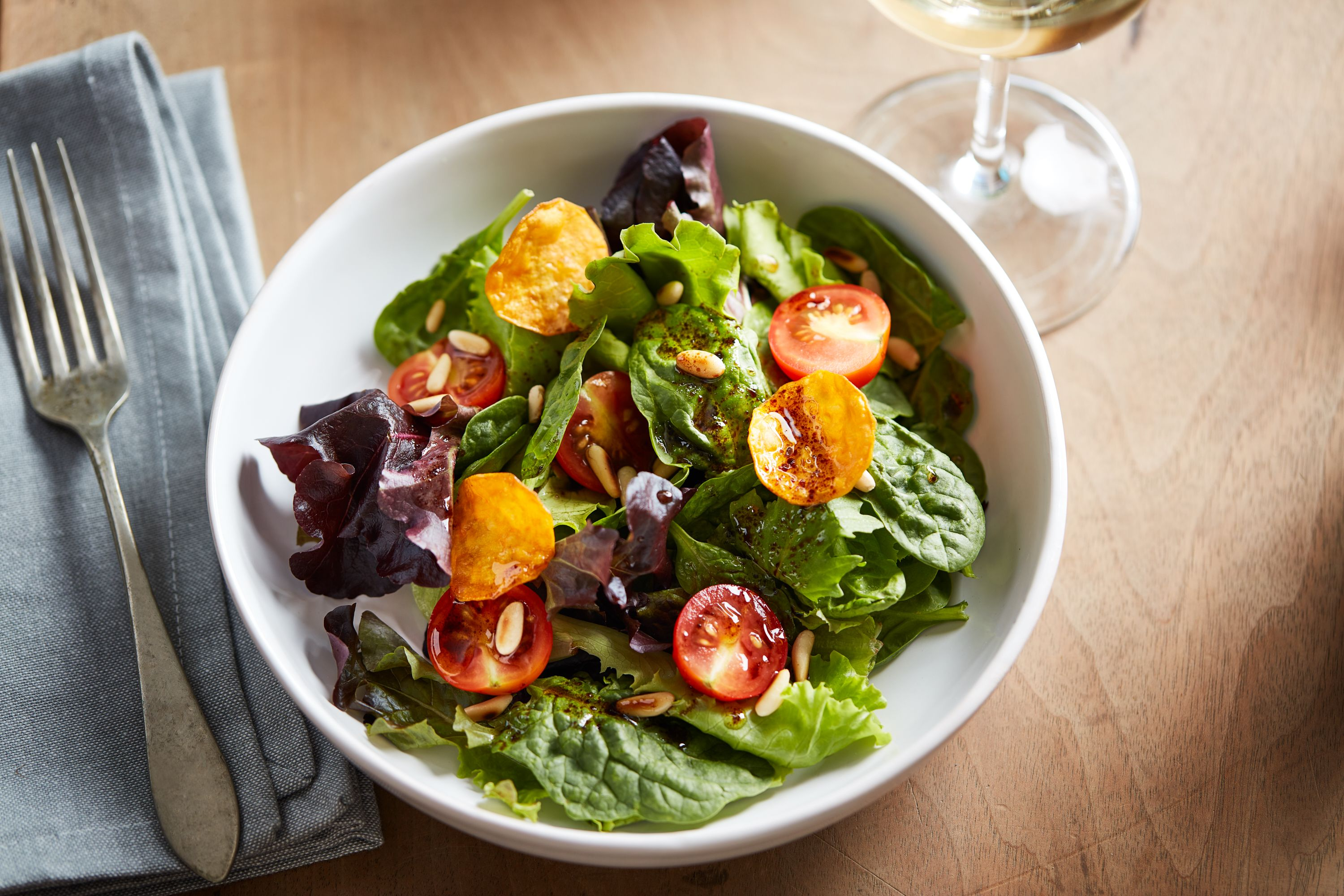 Spinach Salad with Sweet Potato Chips and Pine Nuts