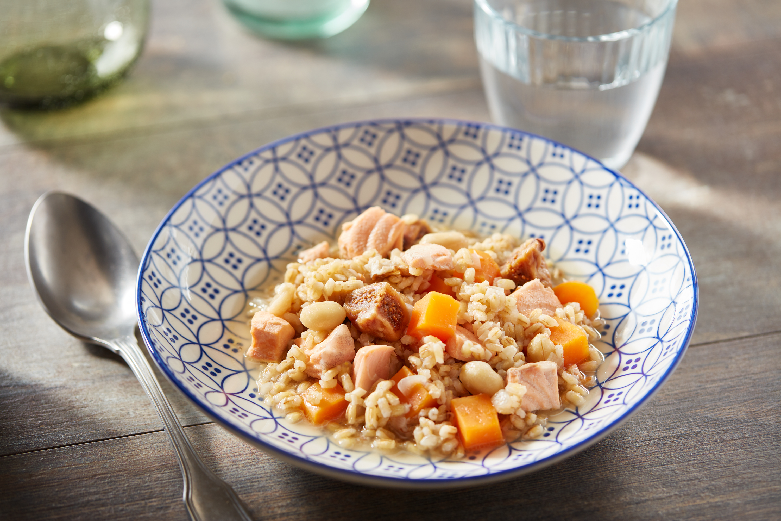 Barley casserole with shiitake mushrooms, salmon, dried figs and peanuts