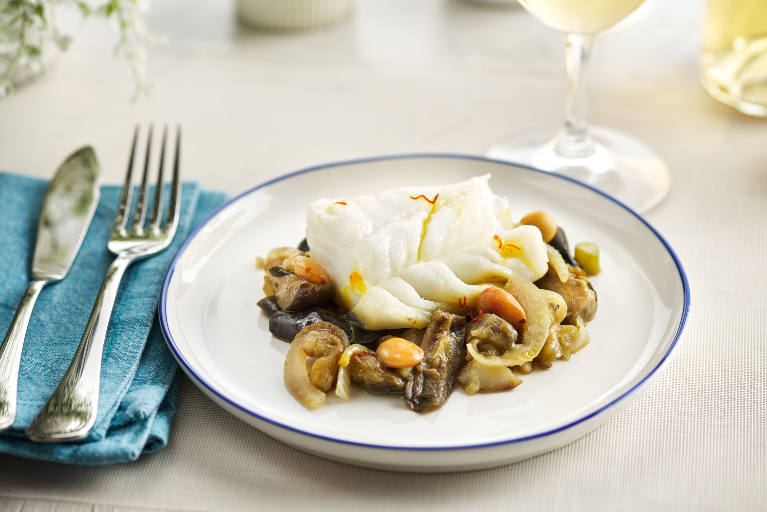 {Fresh cod with aubergine, raw almonds and fennel}